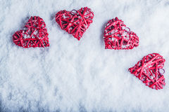 Four beautiful romantic vintage hearts on a white frosty snow background Royalty Free Stock Photography