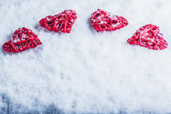 Four beautiful romantic vintage hearts on a white frosty snow background Royalty Free Stock Photo