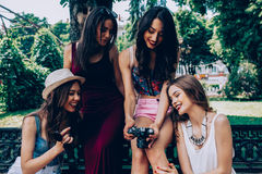Four beautiful young girls consider the camera Royalty Free Stock Images