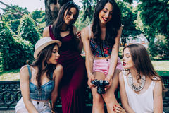 Four beautiful young girls consider the camera Stock Photo