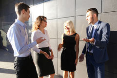 Four beautiful young people, two women and two men talk, chatter Stock Photography
