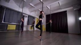 Four beautiful young women dancing a dance pylon