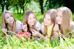 Four beautiful young women girl friends outdoors Stock Photo