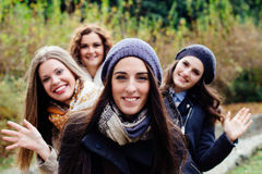 Four beautiful young women waving Royalty Free Stock Photos