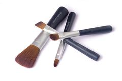 Four beauty brushes Stock Image