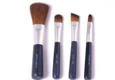 Four beauty brushes Stock Images