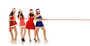 Four beauty girls pull red ribbon Royalty Free Stock Images