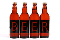 Four beer bottles Royalty Free Stock Photos