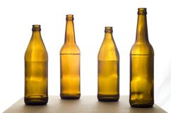 Four Beer Bottles on the Table. Four empty beer bottles on the table. Isolated on a white background Stock Images