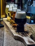 Four beers in Irish pub. Four beers stout, ale, lager, belgian white in Irish pub `Ticket to Doublin`. Russia, Tyumen Royalty Free Stock Photography