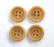 Four Beige Plastic Buttons Isolated on White stock photography