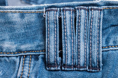 Four belt loops. Close up detail four belt loops on blue jeans royalty free stock photos
