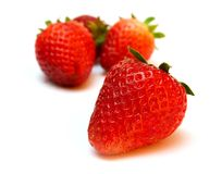 Four berries. Four strawberries isolated on white background royalty free stock image
