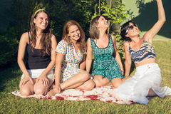 Four best girl friends in the garden Stock Photo
