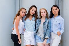 Four best girlfriends looking at camera together. people, lifestyle, friendship, vocation royalty free stock images