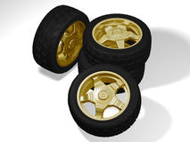 Four big golden wheels. Without any brand for rims and tyres royalty free stock photography