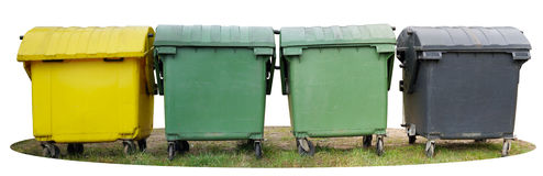 Four big isolated plastic trash bin are located on a green gras. S. Color of objects - yellow, green and black. Panoramic collage from several photos stock photography