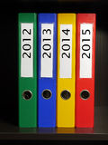 Four binders Stock Photos