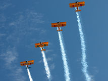 Four Biplanes with Smoke Climbing Stock Photography