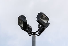 Four black flood lights at top of post Stock Image