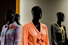 Four black mannequins in fancy, vintage clothes and jewellery. royalty free stock image
