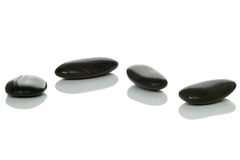 Four black pebbles Stock Photo