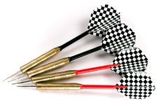 Four black and red darts. Four darts with black and red shafts, black and white checkered feathers, shot isolated against a white background Stock Photo