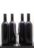Four black red wine bottles Royalty Free Stock Photos