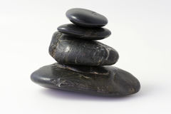 Four black stones stock photo