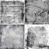Four black and white grunge textures Royalty Free Stock Photo