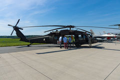 A four-bladed, twin-engine, medium-lift utility helicopter HH-60M Black Hawk MEDEVAC. BERLIN, GERMANY - MAY 21, 2014: A four-bladed, twin-engine, medium-lift Stock Photography