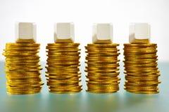 Four blank block over gold coins Stock Photos