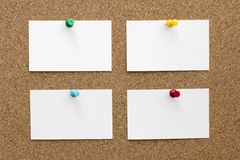 Four Blank Business Cards Pinned to Cork Board Stock Photo