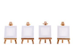 Four blank canvases on easels Royalty Free Stock Images