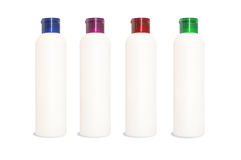 Four blank cosmetics bottles Stock Photo