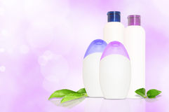 Four blank cosmetics bottles Stock Photography
