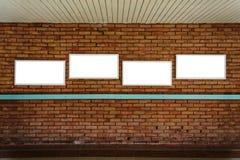 Four blank frame mock up on a brick wall. Four blank frame mock up on a old brick wall Royalty Free Stock Photos