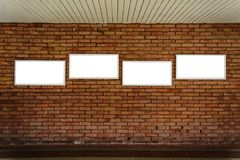 Four blank frame mock up on a brick wall. Four blank frame mock up on a old brick wall Royalty Free Stock Images