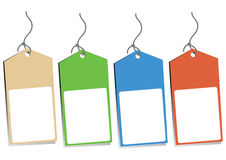 Four Blank Hang Tags. Four hang tags with empty space for your text - tan, green, blue and orange Stock Image