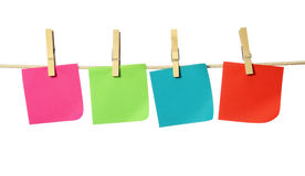 Four blank notes. Hanging on the clothesline isolated on white background Royalty Free Stock Images