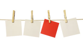Four blank notes. Hanging on the clothesline isolated on white background Royalty Free Stock Photography