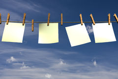 Four blank pieces of paper hanging on a rope. Four blank pieces of paper hanging on a clothesline Royalty Free Stock Photos