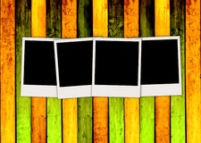 Four Blank Polaroids on Colorful Wooden Backgrou. Four empty photos on multi-colored wooden planks background. A great frame for your images. Please visit my Royalty Free Stock Photography