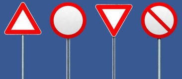 Four blank road signs. Stock Photo