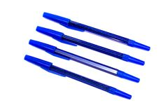 Four blue ballpoint pens close-up, isolate on white background. Four blue ballpoint pens close up, isolate on a white background royalty free stock photos