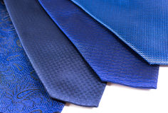 Four Blue Business Ties on White Background Royalty Free Stock Photo