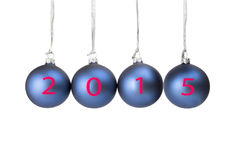 Four blue christmas balls with numbers of present year Royalty Free Stock Photos