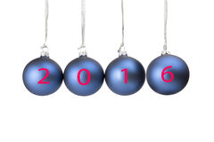 Four blue christmas baubles symbolizing new year 2016 Stock Photos