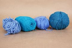 Four blue clews on brown paper Royalty Free Stock Images