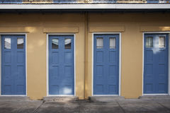 Four blue doors. Four doors on a cottage painted blue Stock Image